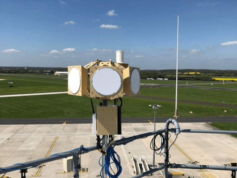 airfield with a close in range view of a tracking equipment for aeroplanes
