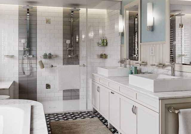 Open plan bathroom, including a bath and a shower, with sink, all white