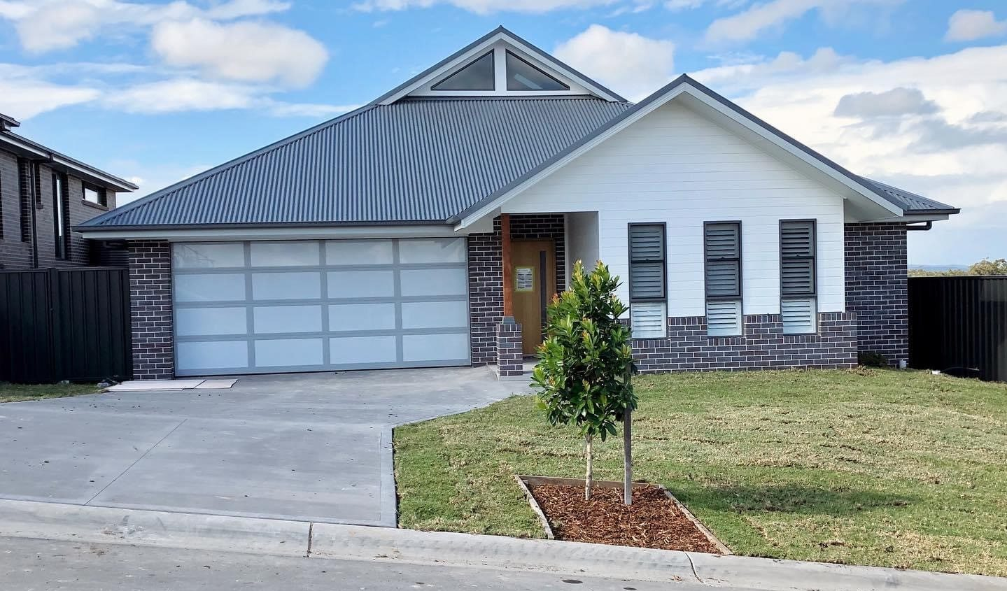 house with long driveway – newly built