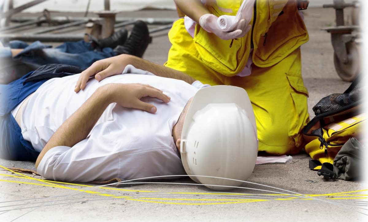 someone laying on the floor receiving treatment from paramedic